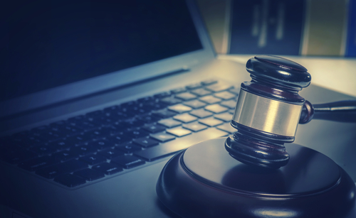 a gavel on a computer symbolizing virtual litigation services