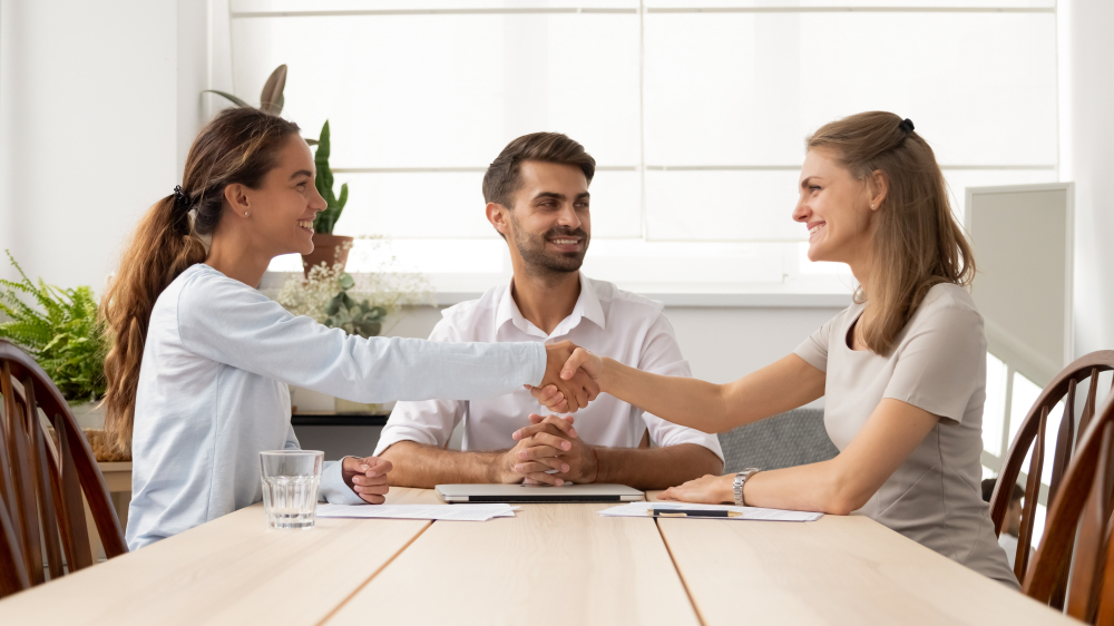 an image of business partners agreeing on a settlement with the help of a mediator